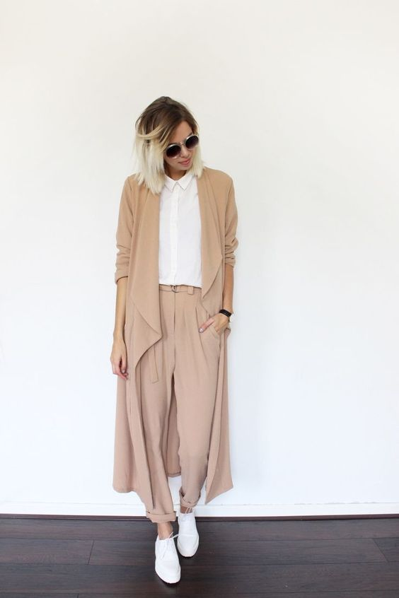 a camel suit with cropped pants and a duster, a white button down and white sneakers
