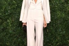 09 a chic creamy pantsuit with a vest instead of a top, a black clutch and statement earrings for a more formal look