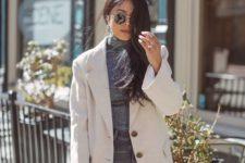 09 a grey turtleneck, grey jeans, a creamy oversized blazer and a small grey wicker bag