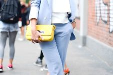 09 a light blue pantsuit, a white top, a yellow clutch and blakc and metallic shoes