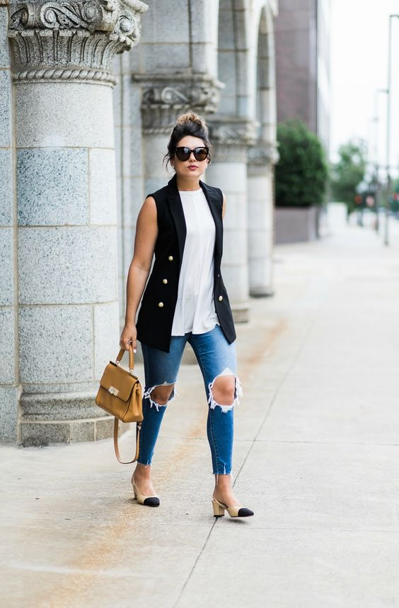 blue ripped jeans, a white top, a black sleeveless blazer, a camel bag and nude and black slingbacks