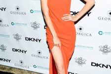 10 Gigi Hadid wearing an orange maxi slip dress with invisible straps and spiked shoes
