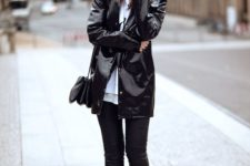10 a black riancoat and black skinnies, black booties and a black bag for a chic and comfy look