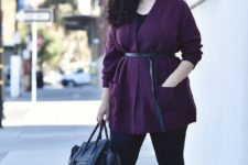 10 a black top, black leggings, black heels, a navy bag and a purple cardigan with a belt