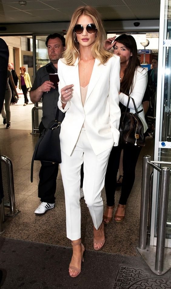 a creamy pantsuit, a small nude top, nude ankle strap heels and a necklace