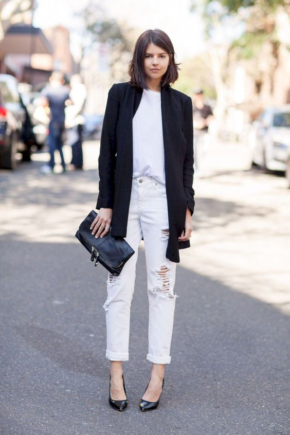 a white tee, white ripped jeans, blakc shoes, a black blazer and a black clutch
