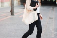 10 black skinnies, a white top, an airy nude shirt, black and nude shoes and a black clutch