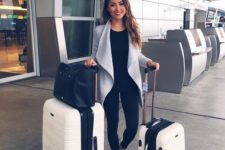 11 a black tee, black leggings, a grey duster and white sneakers for a laconic and simple look