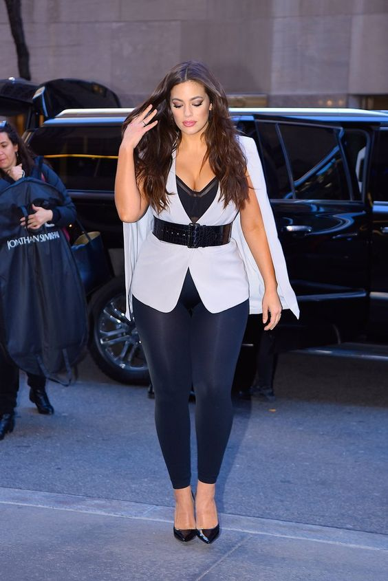 a bold party look with navy leggings, a black bra, a white cape with a wide belt and black shoes