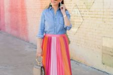 11 a color block pleated midi skirt, a chambray shirt colorful shoes and a small bag
