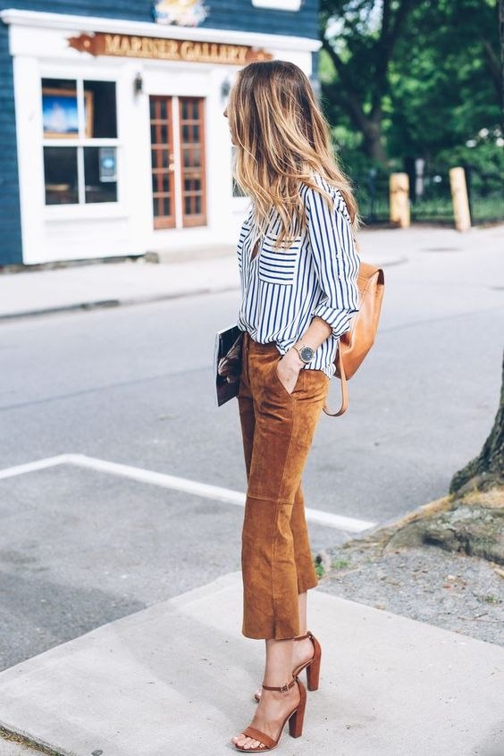 a striped button down, camel cropped pants, brown heeled sandals and a brown backpack