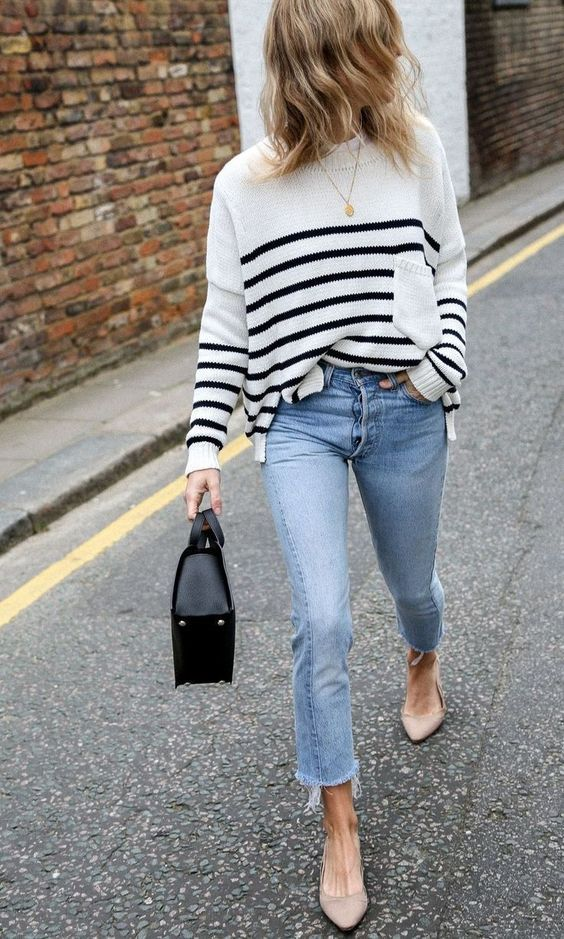 a striped top, blue cropped jeans, nude shoes and a black bag for a comfy spring look
