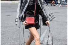 11 a transparent raincoat over a black leather jacket to give your look an ultra-modern feel