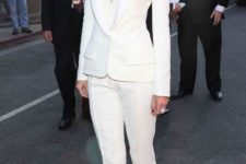 11 a white pantsuit with a white top with a plunging neckline underneath and gorgeous metallic shoes