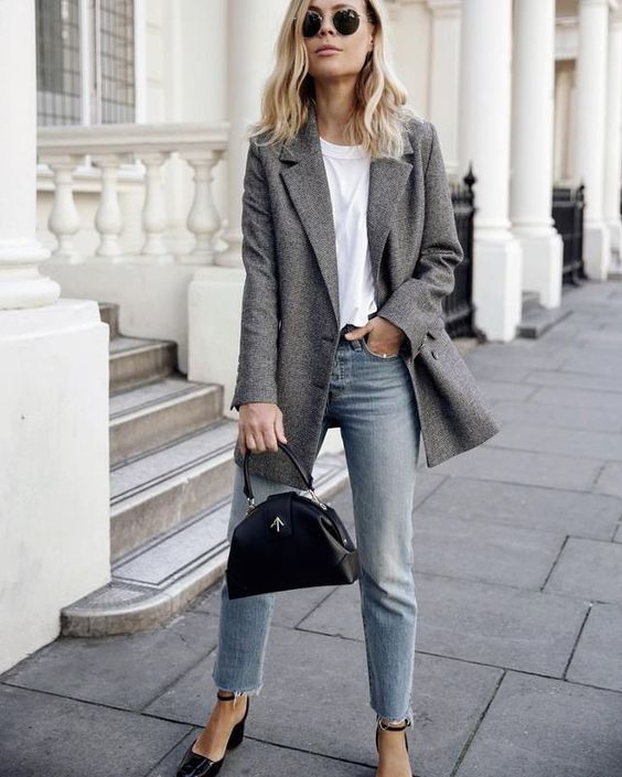 a white tee, a grey blazer, blue cropped jeans and black shoes with ankle straps