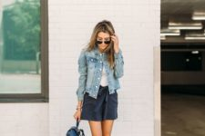 11 a white tee, black shorts, a blue denim jacket, white loafers and a navy bag