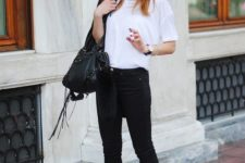 11 black cropped jeans, a white tee, white platform sneakers, a black leather jacket and a black bag