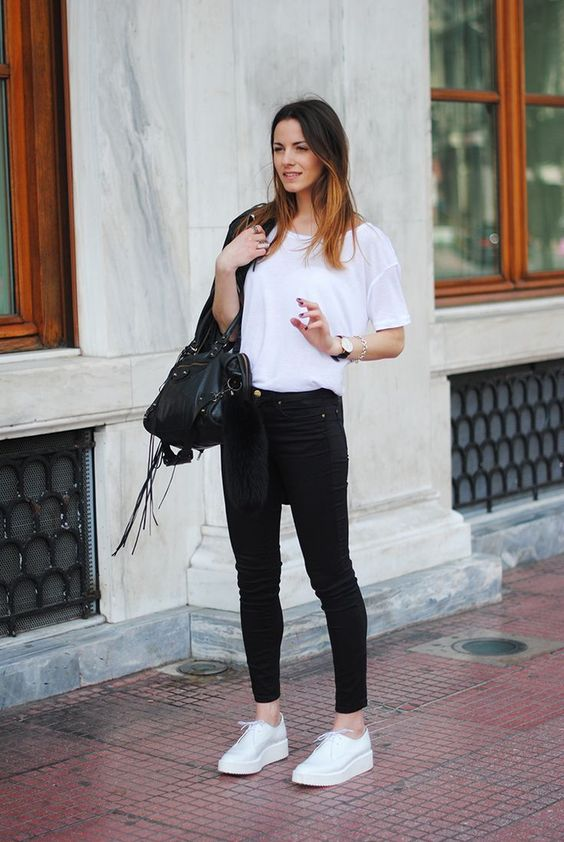 black cropped jeans, a white tee, white platform sneakers, a black leather jacket and a black bag