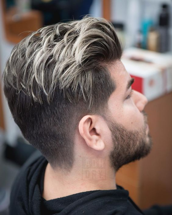 blonde highlights give a texture and a dimension to the haircut