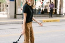 12 a black tee, camel cropped pants, leopard print shoes and a catchy box bag