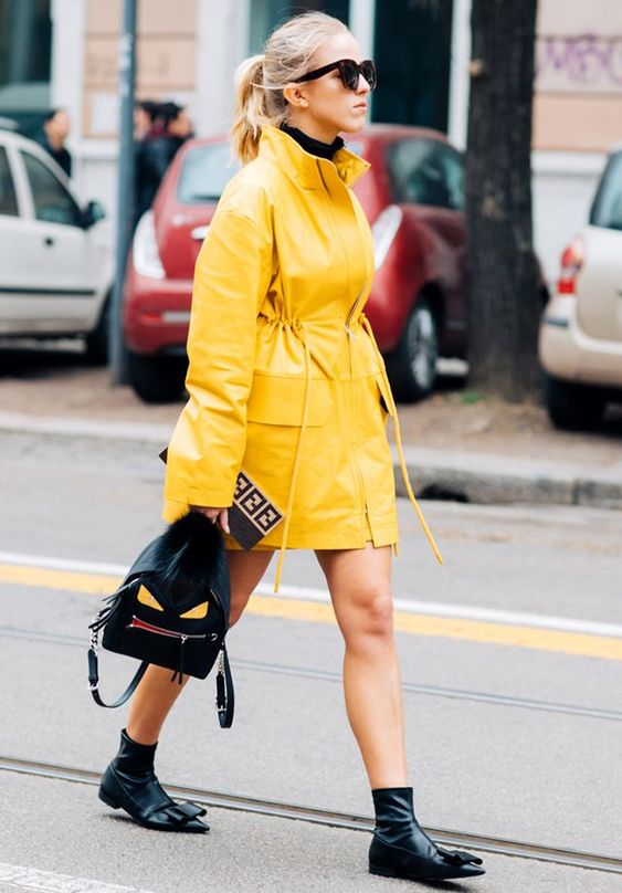 a bright yellow raincoat is a chic idea for your trendy spring outfit