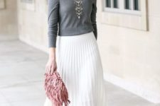 12 a grey off the shoulder top, a white pleated midi skirt, lace up shoes and a pink fringe clutch