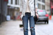 12 a neutral printed tee, a white leather jacket, blue ripped jeans and black shoes