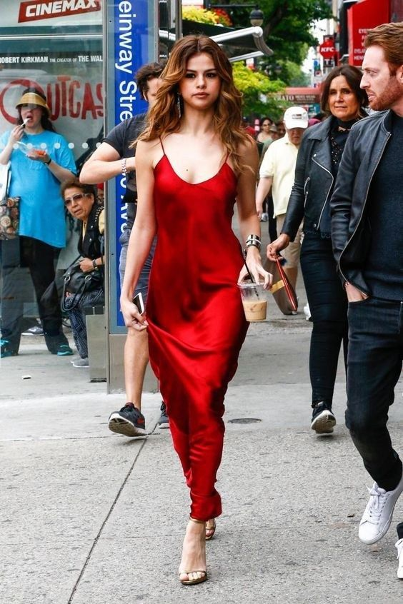a red slip dress and metallic heels will get all the eyes on you - it's a very bold and sexy option