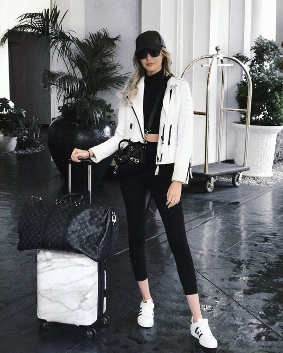 a white sweatshirt, blush pants, blush sneakers and a black bag for maximal comfort