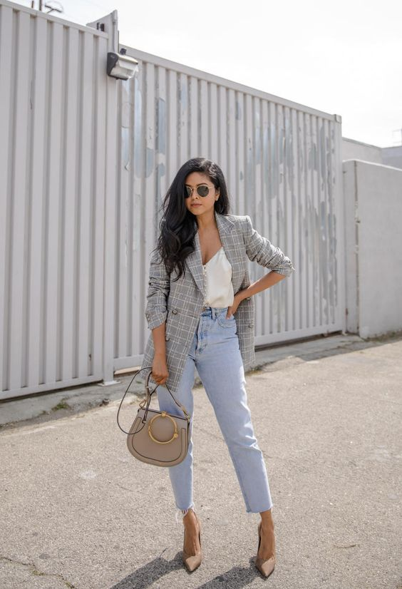 a white top with buttons, blue high waisted jeans, nude shoes and a grey checked blazer plus a grey bag