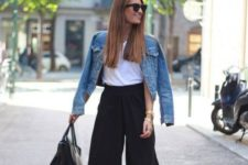 12 black culottes, a white tee, a blue denim jacket, black heels and a black bag