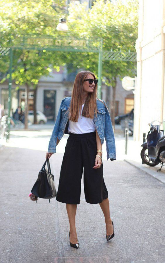 black culottes, a white tee, a blue denim jacket, black heels and a black bag