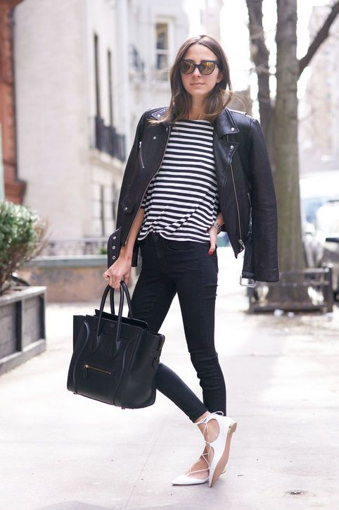 black jeans, a black and white striped top, a black leather jacket, a black bag