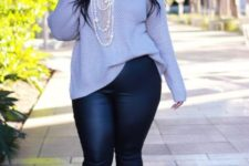 13 a grey sweater, black leather leggings, burgundy shoes and pearl stands