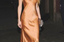 13 a rust slip midi dress, a statement necklace and earrings, a metallic clutch and nude strappy heels by Amber Heard