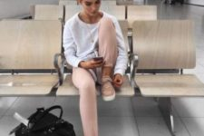 13 a white sweatshirt, blush pants, blush sneakers and a black bag for maximal comfort