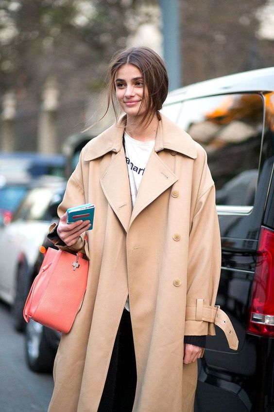 an oversized beige trench is a cool idea for this spring, it guarantees a hot look