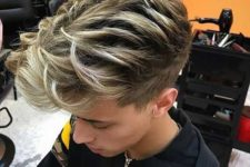 13 an undercut haircut with blonde balayage features much texture and a cool volume