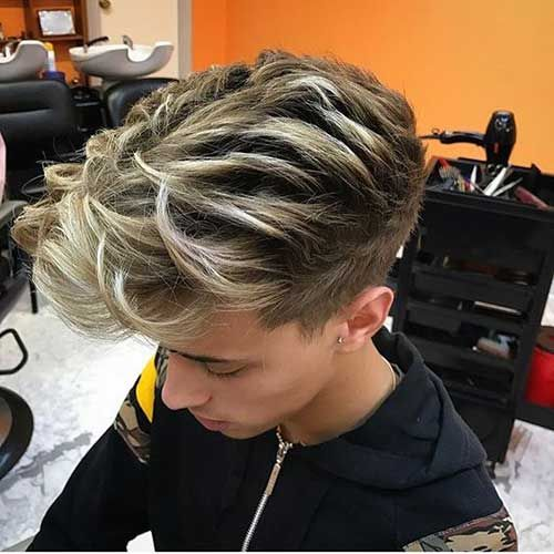an undercut haircut with blonde balayage features much texture and a cool volume