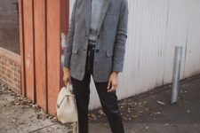 13 black leather pants, a grey turtleneck, a grey oversized blazer, white shoes and a creamy bag