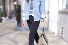 13 black pants, a striped top, a blue denim jacket, snake print shoes and a neutral bag