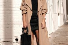 14 a beige and black outfit with an oversized trench is sure to make you look edgy