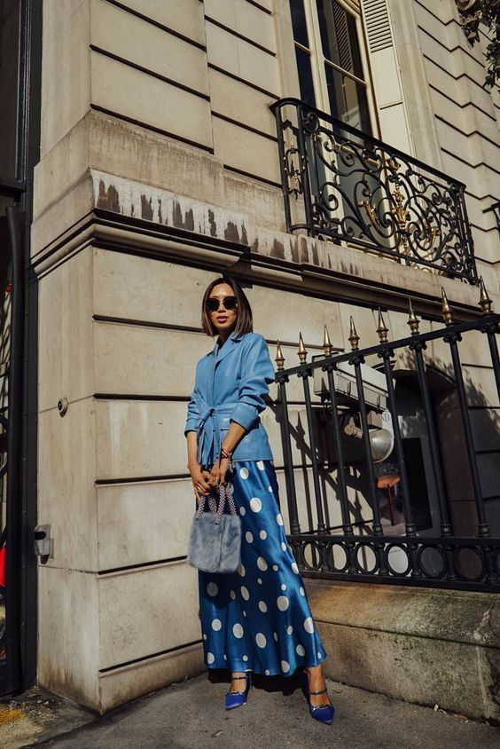a blue maxi dress dress with large white polka dots, a blue leather jacket, electric blue shoes