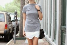 14 a grey tee, a white asymmetrical skirt, silver Oxford shoes and a black bag