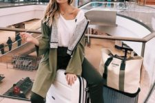 14 a white tee, an olive green jacket, dark green cropped pants, white sneakers for a sporty and comfy look