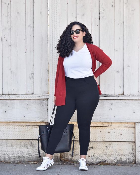 a white tee, black leggings, a grey bag, white sneakers and a red cardigan for a casual look