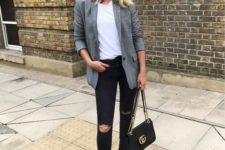 14 black ripped jeans, a white tee, a grey blazer, snake print loafers and a black bag