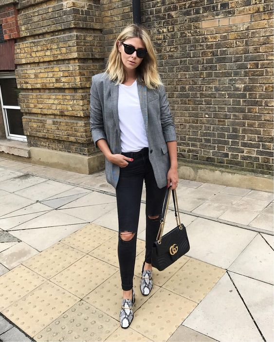 black ripped jeans, a white tee, a grey blazer, snake print loafers and a black bag