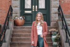 14 navy jeans with fringe, a printed tee, a coral oversized blazer and black moccasins