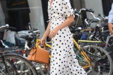 15 a black and white midi polka dot dress, white flats and a camel bag